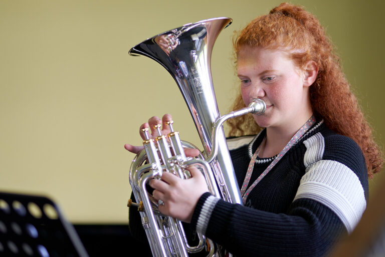 Music student playing tuba